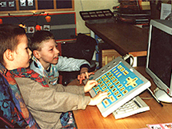 Students in Poland working together on the computer