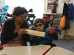 Usha working with a student